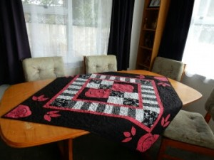 Roses quilt on table (1)